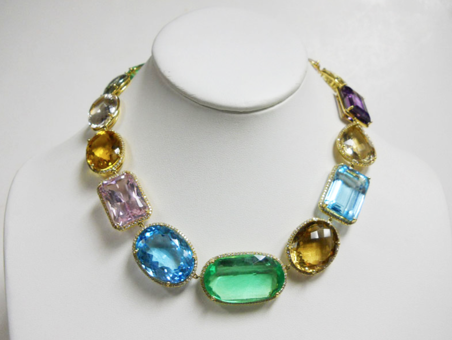 Alexia Echevarria wears this vibrant multi color gemstone & diamond necklace featuring kunzite, citrine, blue topaz, rock crystal and green quartz to an elegant luncheon.