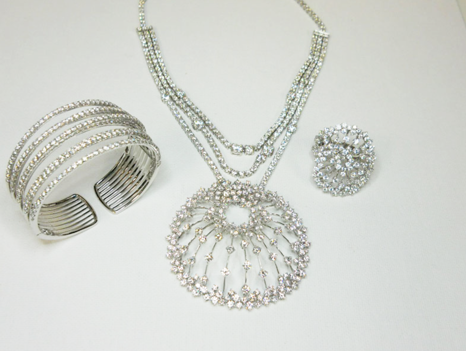 Large diamond 'Starburst' pendant suspended from a triple strand diamond necklace totaling over 40 carats.